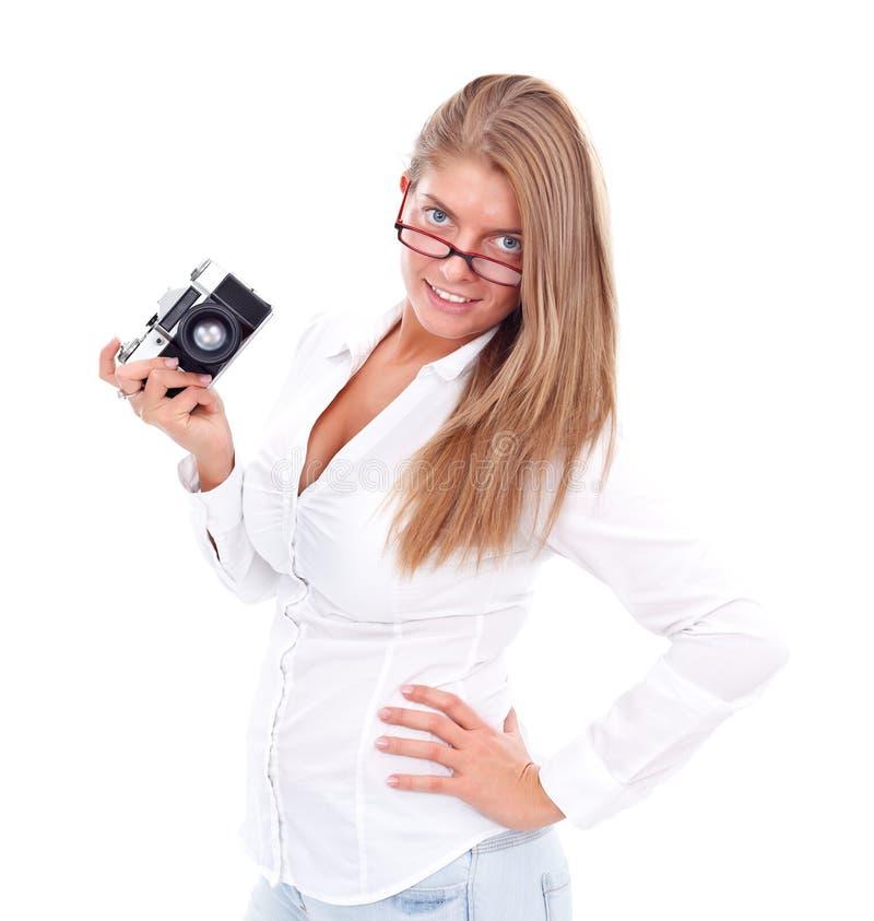 Menina que prende a câmera retro fotografia de stock royalty free