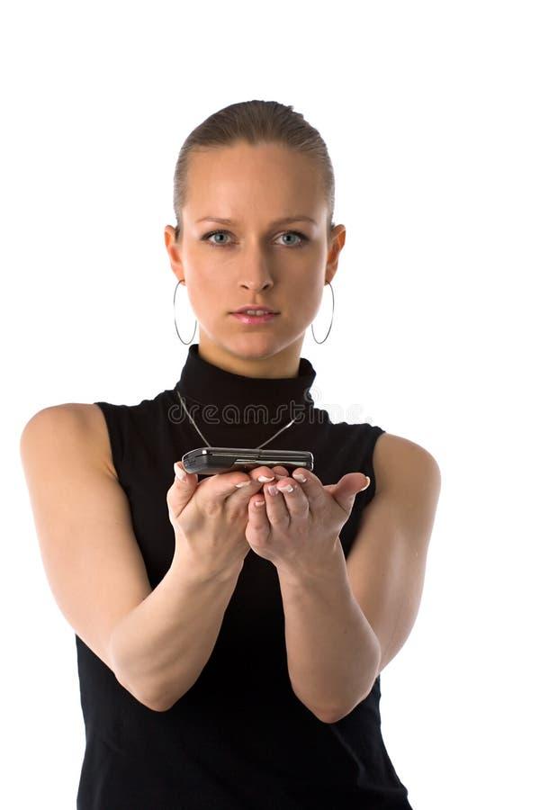 Menina que prende o telefone móvel foto de stock royalty free