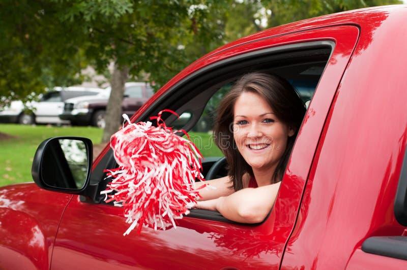 Menina que senta-se no caminhão com Pom Pom foto de stock royalty free