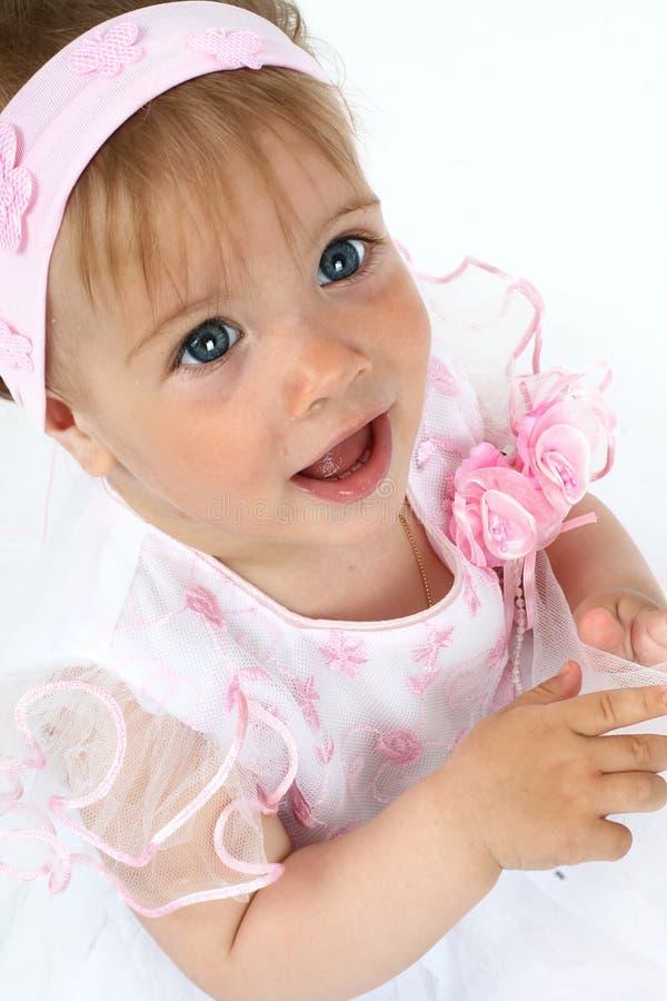 Menina recém-nascida no vestido cor-de-rosa fotos de stock