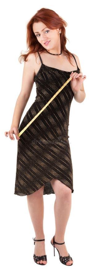 Menina red-haired bonita com medidor à disposicão fotografia de stock