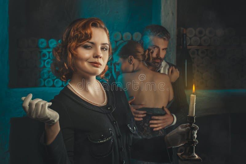 Menina retro com uma vela fotografia de stock royalty free