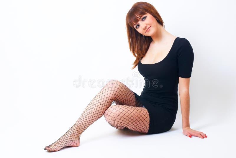Menina ruivo bonita no assoalho foto de stock royalty free