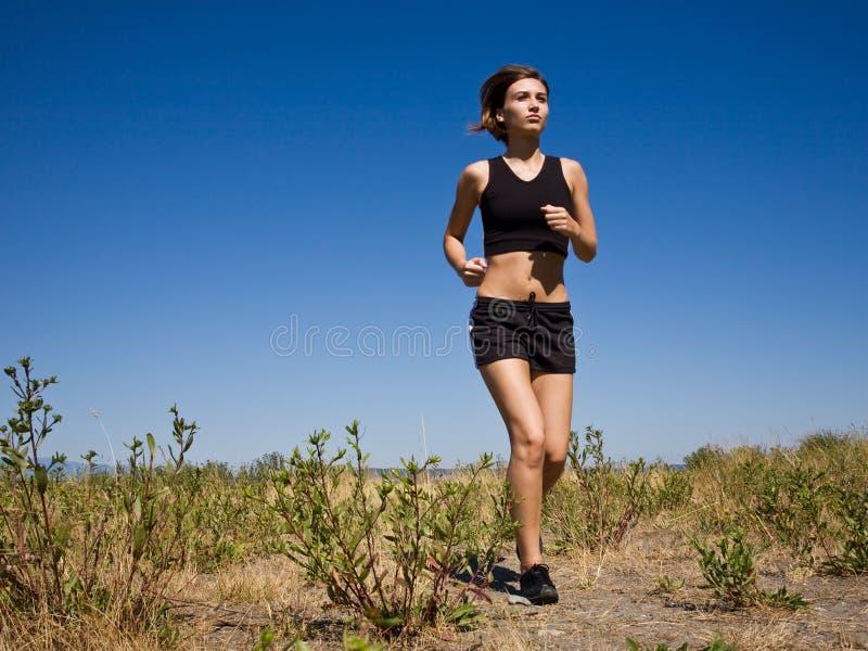 Menina Running fotos de stock