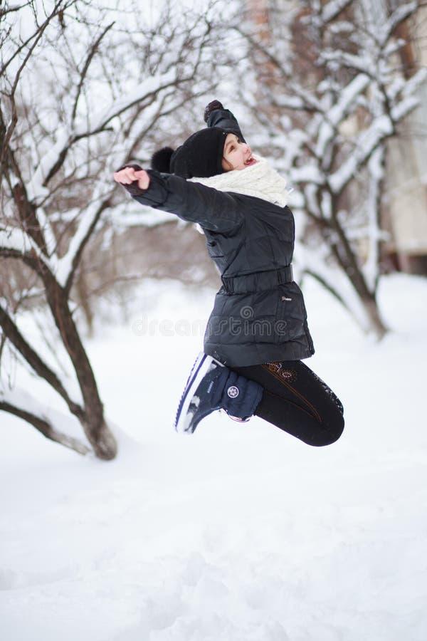 A menina saltada acima fotografia de stock royalty free
