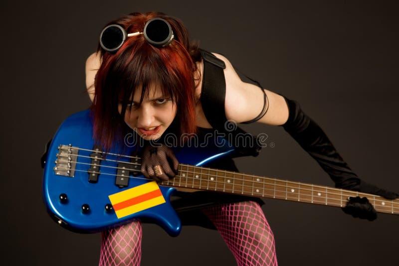 Menina sensual com guitarra baixa imagens de stock royalty free