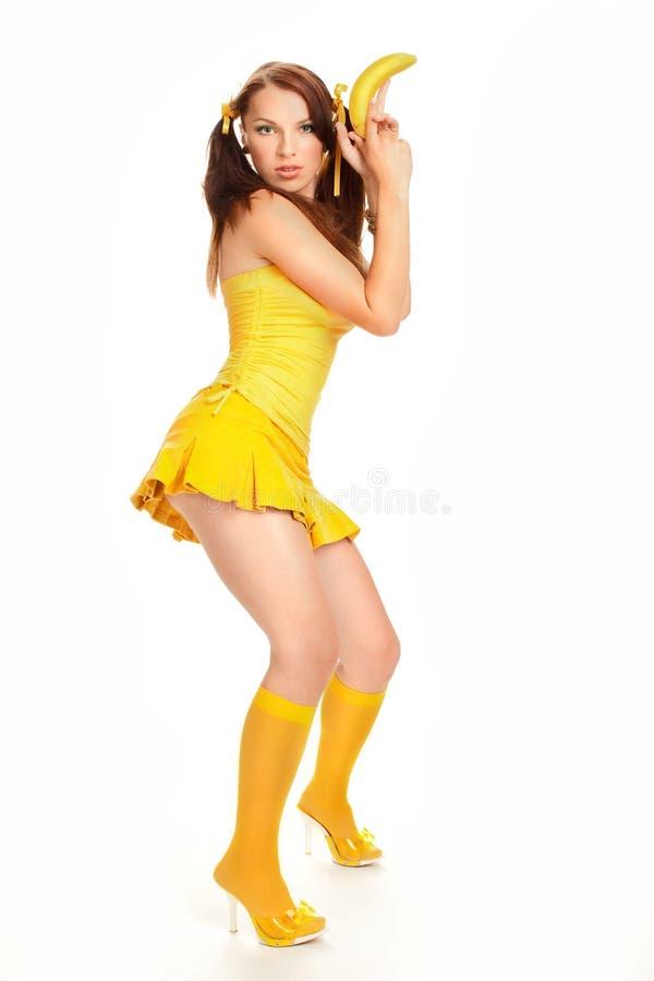 Menina sexual da face no amarelo fotografia de stock royalty free