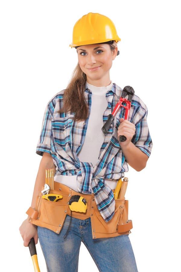 Menina 'sexy' bonita nas ferramentas de terra arrendada do desgaste do trabalho isoladas no branco fotos de stock