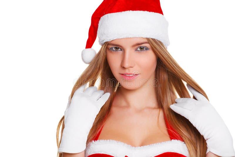 Menina 'sexy' bonita que desgasta a roupa de Papai Noel Isolado no branco fotografia de stock royalty free