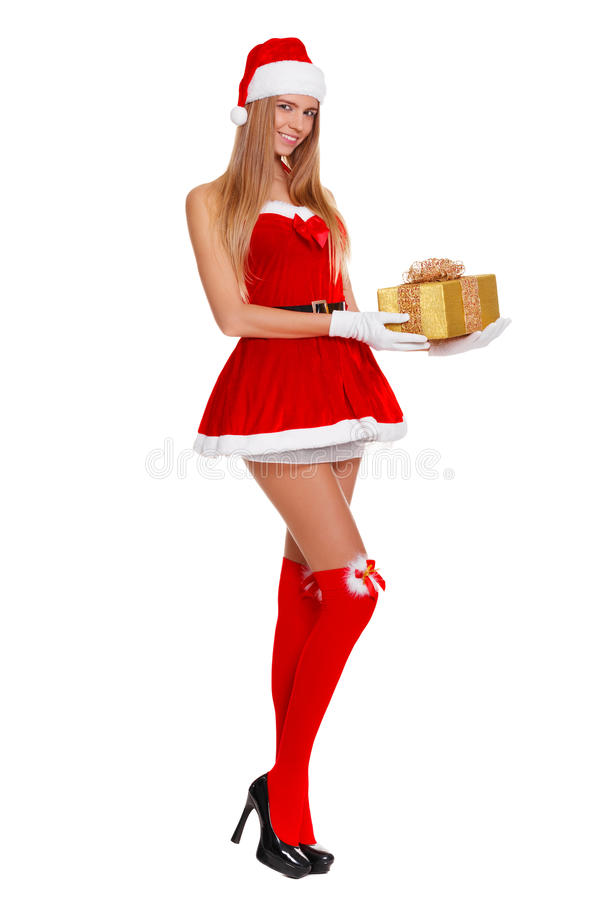 A menina 'sexy' bonita que veste Papai Noel veste-se com presente do Natal Isolado no branco foto de stock royalty free