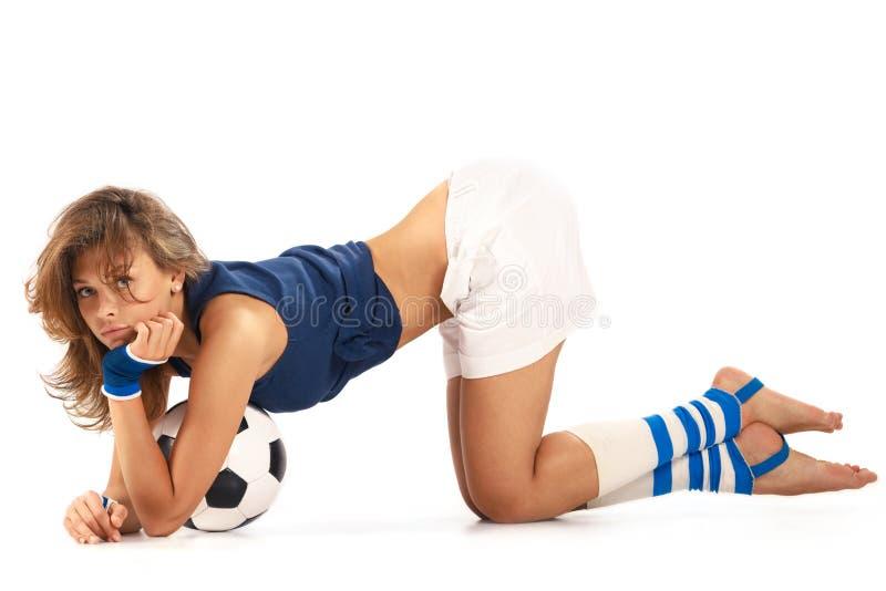Menina 'sexy' com bola de futebol fotografia de stock