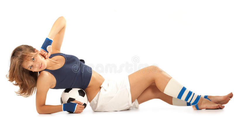 Menina 'sexy' com esfera de futebol fotografia de stock royalty free