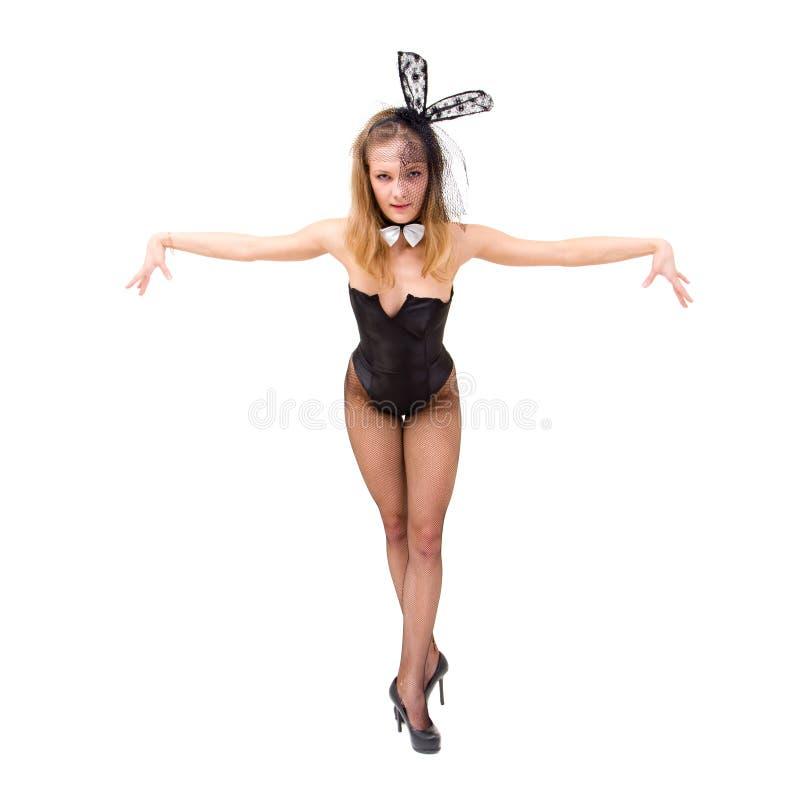 Menina 'sexy' do jogo que veste um levantamento do traje do coelho fotografia de stock royalty free