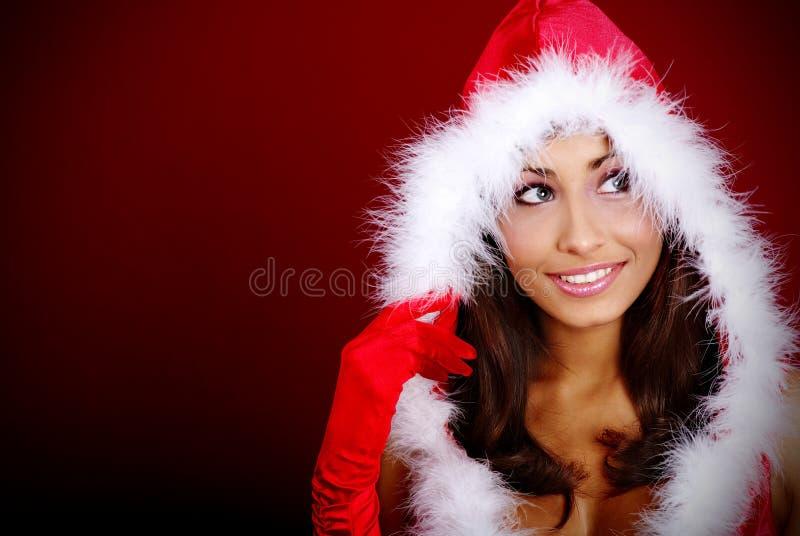 Menina 'sexy' que desgasta a roupa de Papai Noel imagens de stock