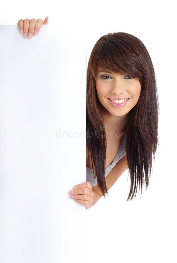Menina 'sexy' que prende a placa branca vazia imagens de stock royalty free