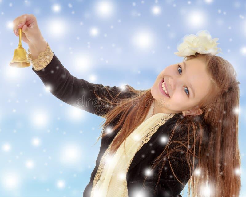 A menina soa o sino imagens de stock royalty free