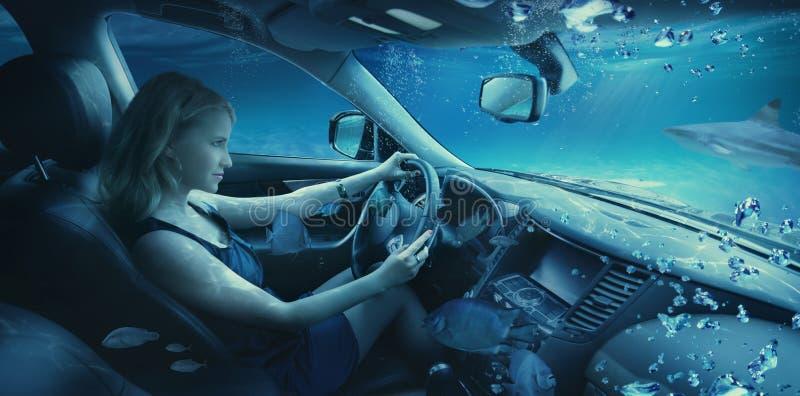 Menina subaquática no carro fotografia de stock