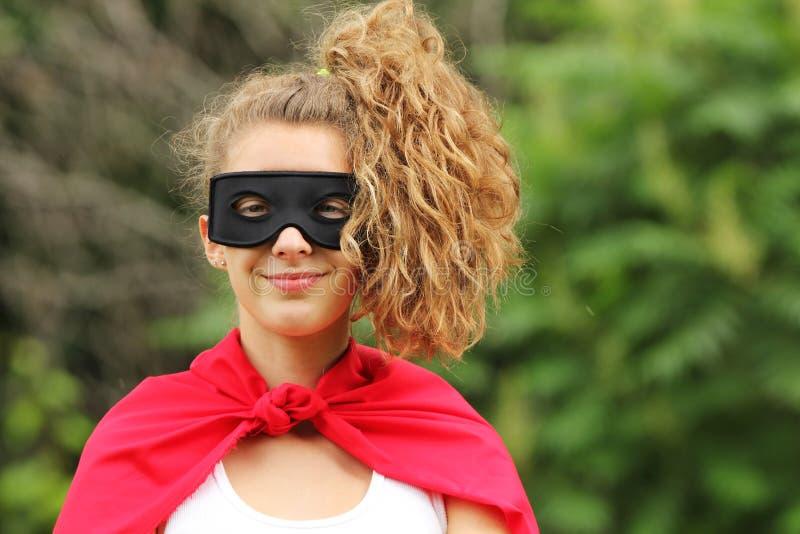 Menina super do herói imagem de stock