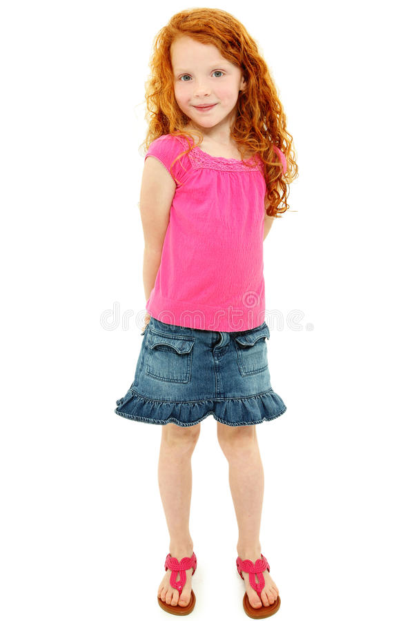 Menina tímida bonita da escola do Redhead sobre o branco imagens de stock royalty free