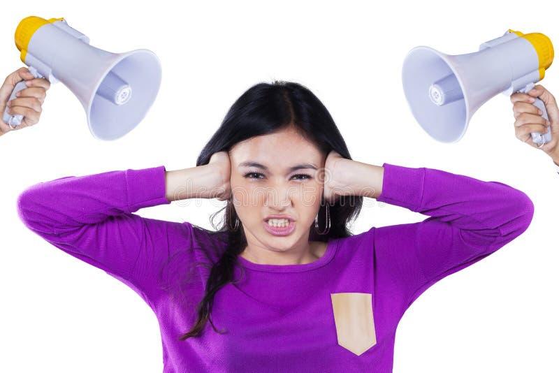 Menina tiranizada com o megafone dois fotos de stock royalty free