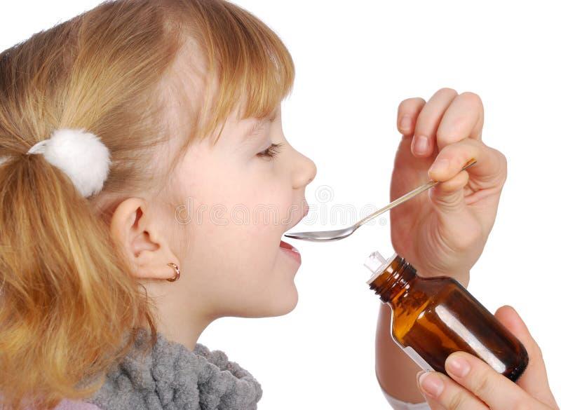 A menina toma a medicina fotografia de stock royalty free