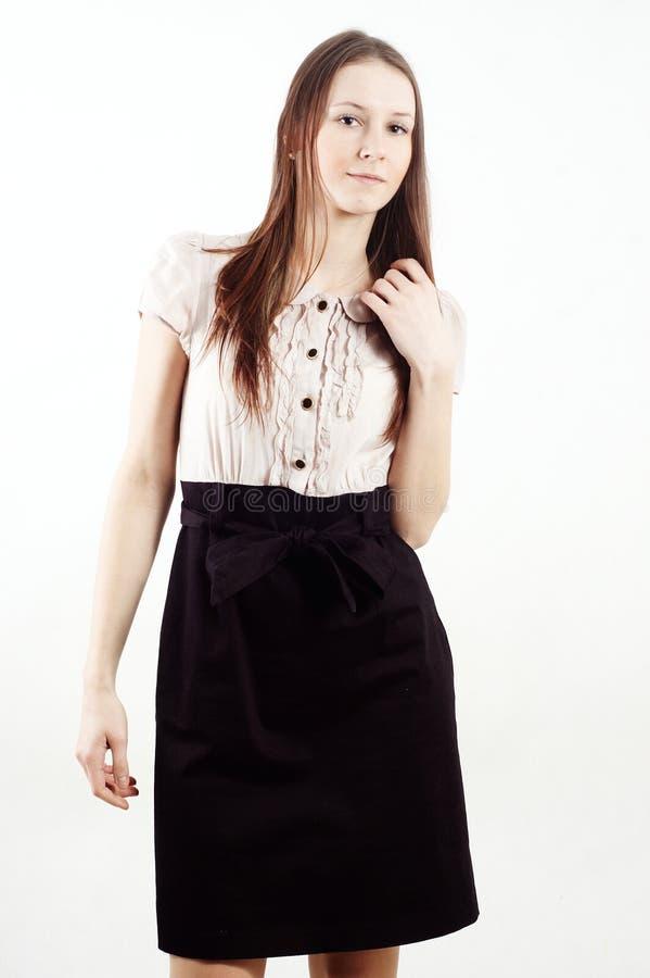 Download Menina Triguenha Agradável Que Desgasta Um Vestido Imagem de Stock - Imagem de bonito, businesswoman: 12811877