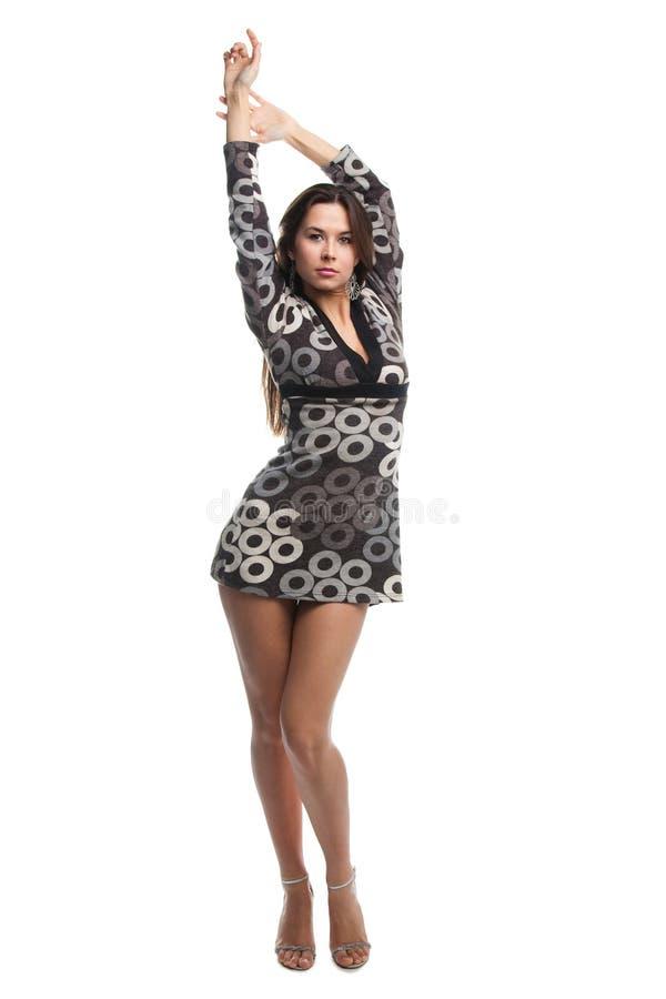 Menina triguenha bonita no vestido curto imagem de stock