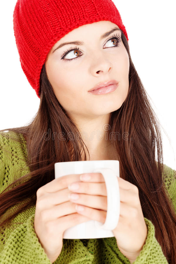 Menina triguenha bonita que prende um teapot fotos de stock royalty free