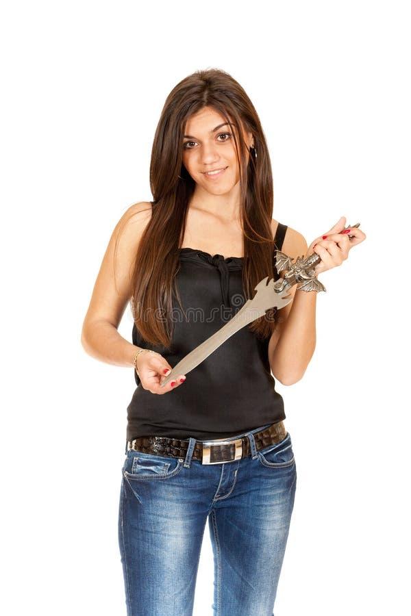 Menina triguenha com um punhal em sua mão fotografia de stock