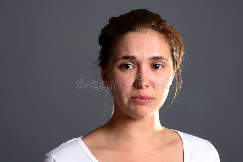 Menina triguenha triste imagem de stock royalty free