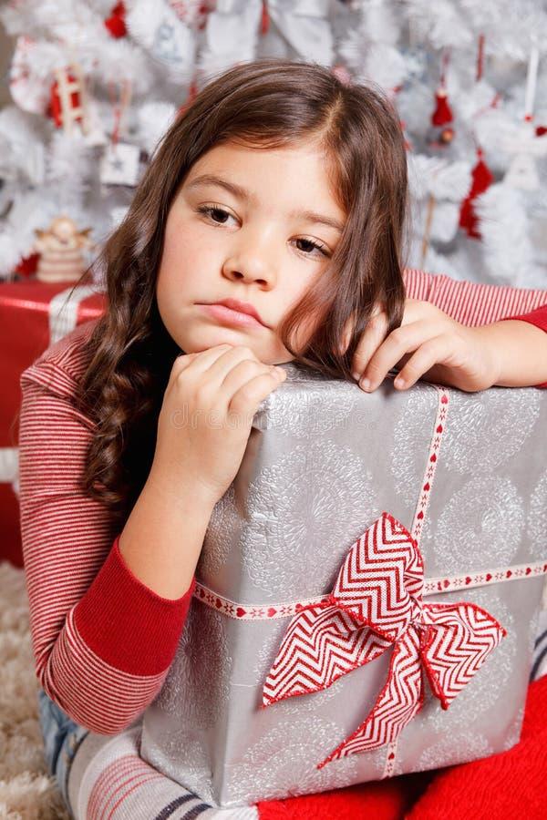 Menina triste no Natal imagens de stock royalty free