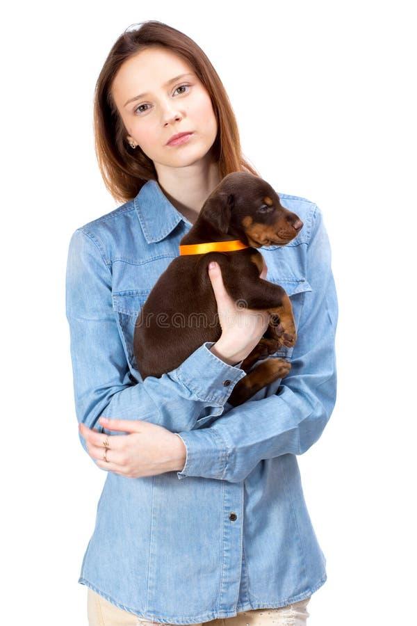 Menina vermelha com cachorrinho imagem de stock