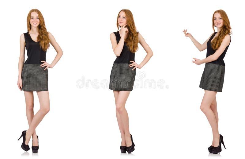 A menina vermelha do cabelo no vestido cinzento isolado no branco foto de stock royalty free