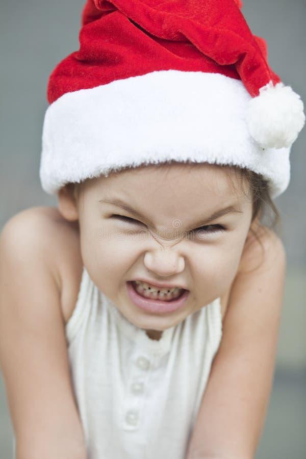A menina vestida como um Papai Noel fotografia de stock
