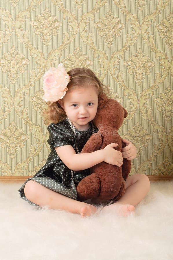 Menina vestida como uma boneca retro fotografia de stock royalty free