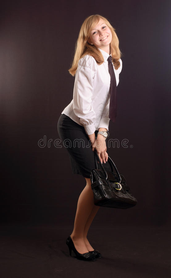 Menina vestida como uma senhora do negócio fotos de stock royalty free