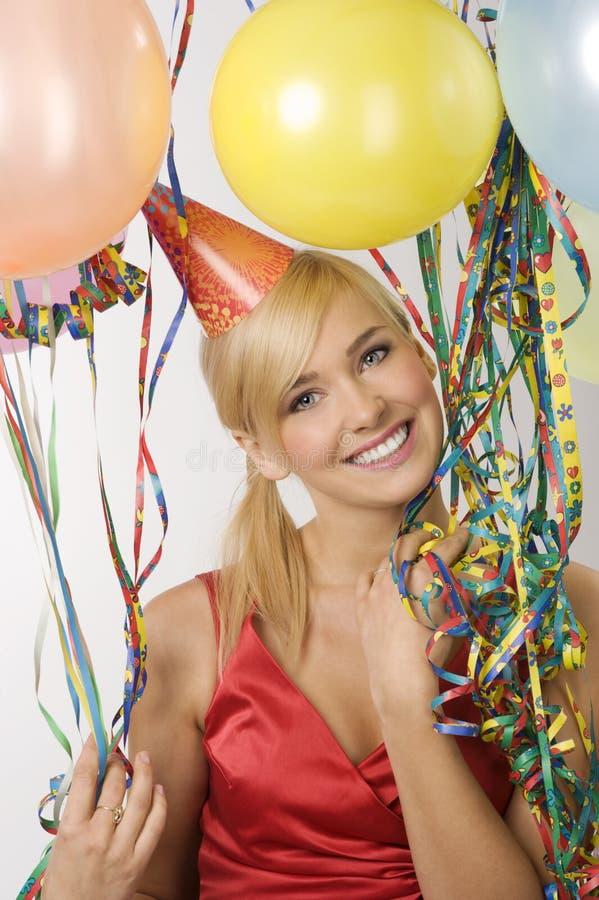 Menina vestida vermelha no partido com balões fotos de stock royalty free