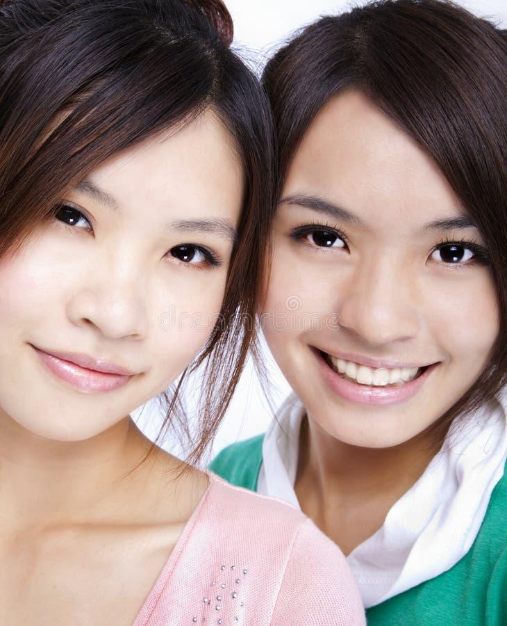 Meninas asiáticas de sorriso foto de stock royalty free