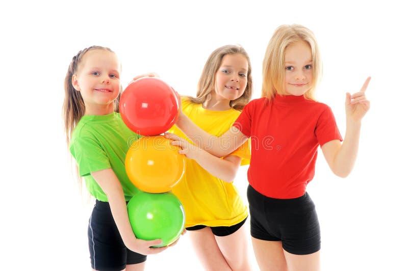 Meninas com bolas coloridas fotografia de stock royalty free