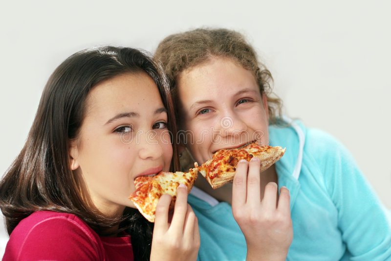 Meninas da pizza fotografia de stock royalty free