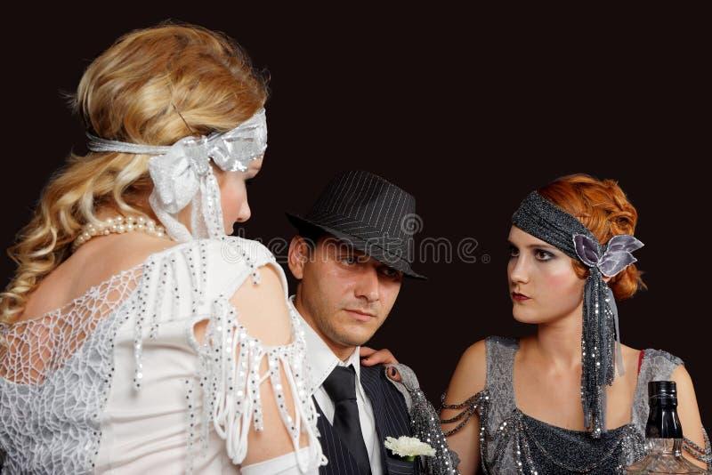 Meninas e gângster do Flapper imagem de stock