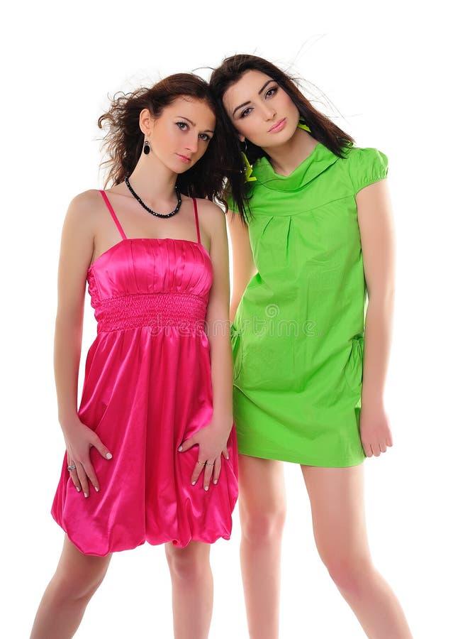 Meninas em vestidos do vintage fotografia de stock