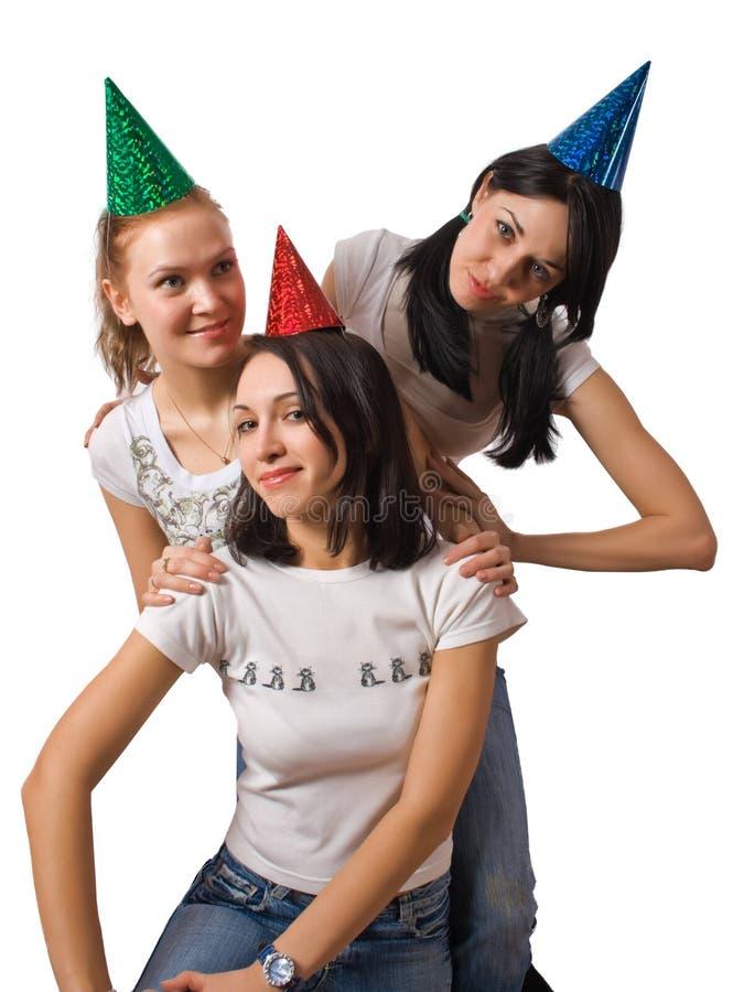 Meninas engraçadas em tampões do tolo imagens de stock