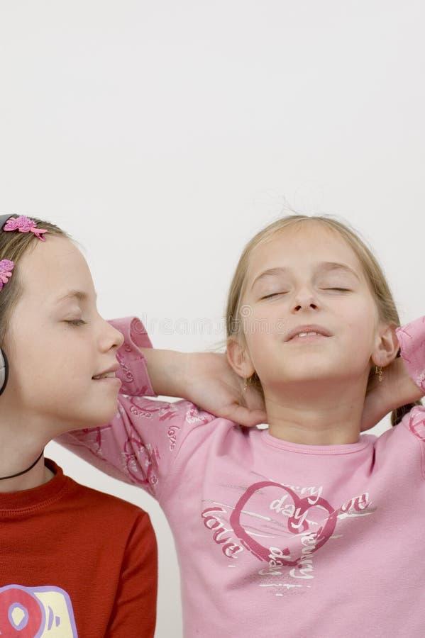Meninas/música/branco imagens de stock