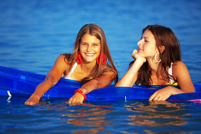 Meninas na água imagem de stock royalty free