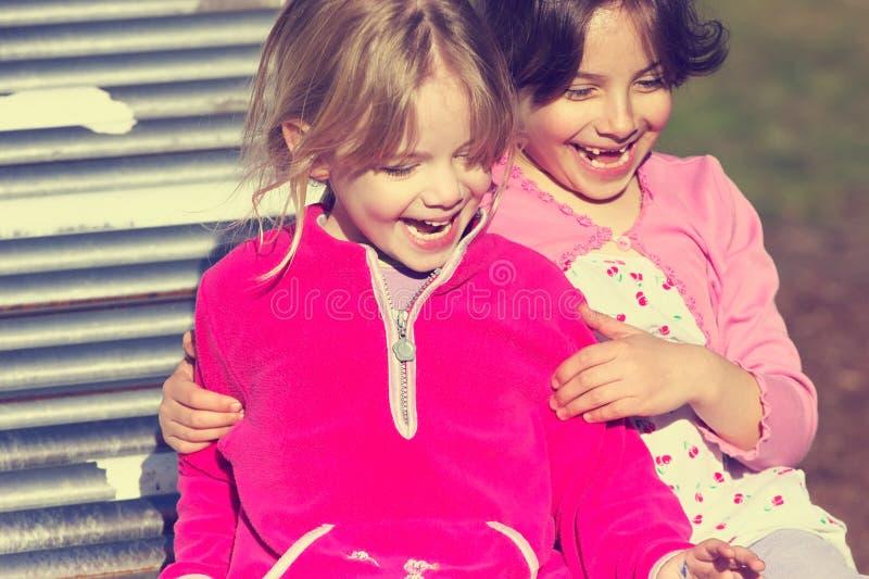 Meninas na corrediça foto de stock
