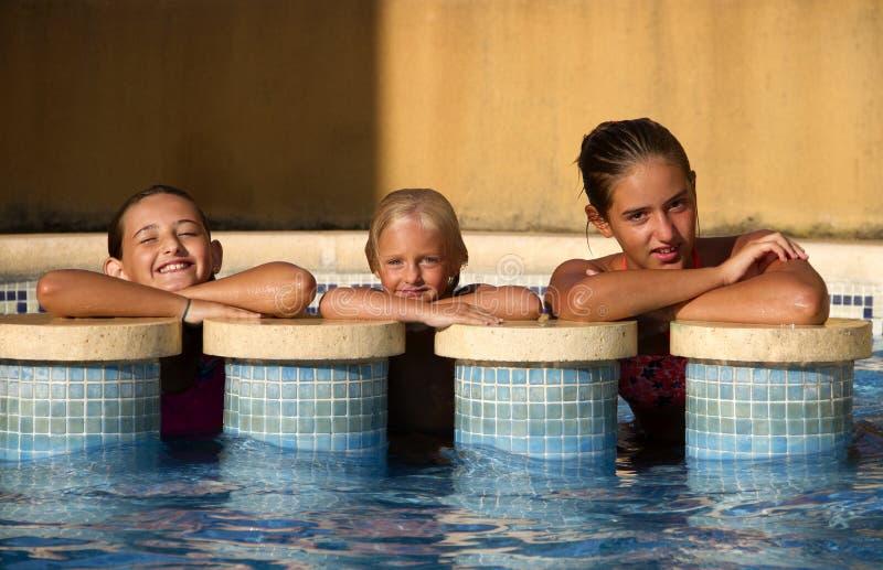 Meninas na piscina imagens de stock royalty free