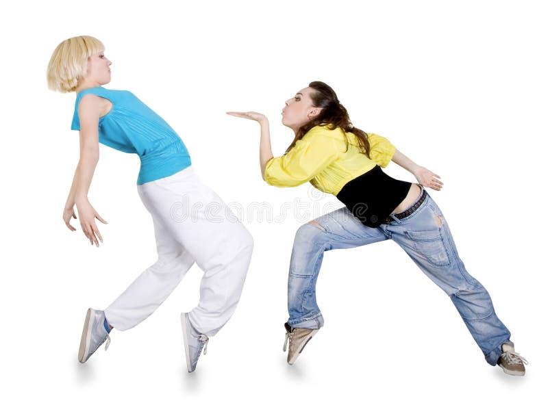 Meninas que dançam hip-hop sobre o fundo branco imagem de stock royalty free