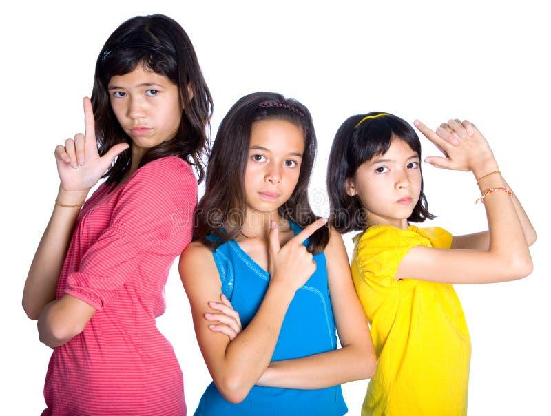 Meninas que fingem ser heróis da ação foto de stock
