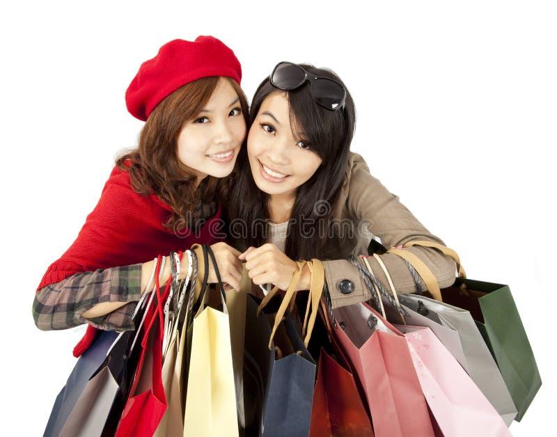 meninas que prendem o saco de compra fotos de stock